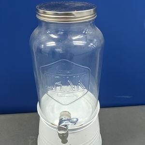 Single glass decanter,on white metal base.